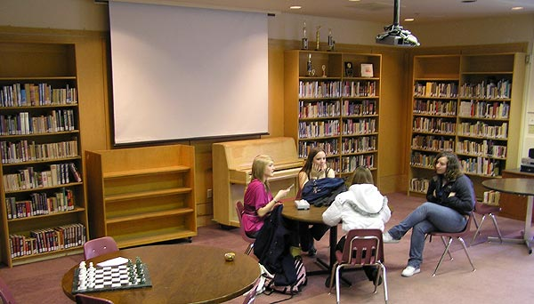 Four students working together in the library